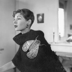 Elsa Schiaparelli, black shetland stole with oversized insect pin, photographed by Robert Randall, 1952