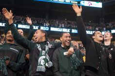 Denzel Valentine and brother Drew celebrate with the men's basketball team during the Big Ten Championship game against Ohio State on Dec. 7, 2013, at Lucas Oil Stadium in Indianapolis, Ind. The Spartans defeated the Buckeyes, 34-24. Danyelle Morrow/The State News