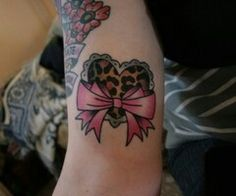 Lace heart and bow tattoo