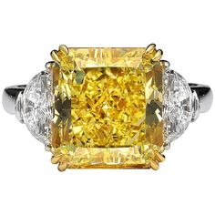 4.70 Carat GIA Cert Fancy Intense Yellow Diamond Gold Platinum Three Stone Ring | From a unique collection of vintage three-stone rings at https://www.1stdibs.com/jewelry/rings/three-stone-rings/