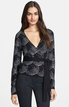 "Free shipping and returns on Diane von Furstenberg 'Ballerina' Embellished Cardigan Sweater at Nordstrom.com. <p><B STYLE=""COLOR:#990000"">Pre-order this style today! Add to Shopping Bag to view approximate ship date. You'll be charged only when your item ships.</b></p><br>Waves of glittering rhinestones sparkle over a stretch-wool cardigan reinvented in Diane von Furstenberg's signature wrap style, its plunging neckline and sash belt designed to flatter all figures."