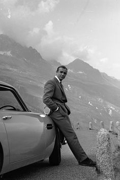 Sean Connery as James Bond with the Aston Martin DB5 in the Swiss Alps, Goldfinger, 1964