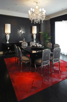 This is a bit of the reverse of what you described and a dining room- but imagine it with a red wall and black carpet.  You can also get the idea of how an area rug brings the furnishings together and adds interest.  If you did this in your dining room the glass table would look teriffic.