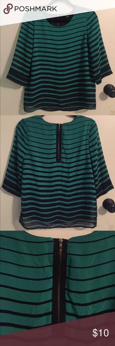 Green and black striped blouse Horizontal striped green and black blouse. Black stripes become thicker toward the bottom of the shirt (and conversely, green stripes get thinner). Back zipper detail & button detail on sleeves. Top: 100% polyester and black inside lining also 100% polyester. Slightly wrinkled in the picture but hardly worn. (Too tight around my chest!) Forever 21 Tops Blouses