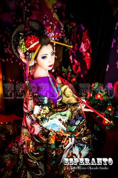 A modern take of an oiran at a kimono photography experience.