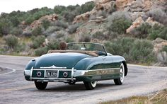 It's Kurtis Sport Car serial number KB003, the actual car that appeared on the cover of the very first edition of the Motor Trend magazine way back in 1949