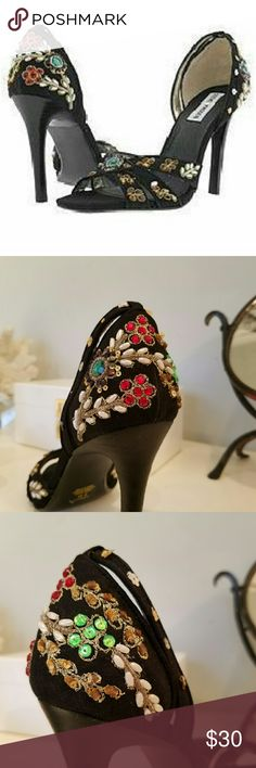 Steve Madden Heels Super Chic embellished Steve Madden heels with intricate beading, embroidery and sequin.  Fabric upper with leather soles.  These shoes look amazing with skinny jeans and are a total head turner with all black outfit.  Worn twice.  No beads or stones missing.  Lightly worn on bottom (see photos) and really great condition. Steve Madden Shoes Heels