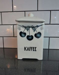 Vintage-German-Pottery-Canister-W-Lid-marked-KAFFEE-Ivory-Black-W-Cherries