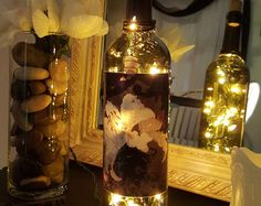 Upcycled, decorative, wine bottle lamp. This bottle is decoupaged with a French-inspired, butterfly label. Bottle is finished with hemp twine,