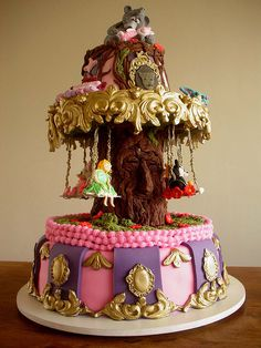 (Disney Swing Carousel Cake!) by Carla Ikeda - Learn how to create your own amazing cakes: www.mycakedecorating.co.za