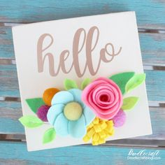 Hello Vinyl Wood Sign with Bright Felt Flowers!  Isnt this sign perfectly bright and cheery!?  I love it and felt flowers are the best!...