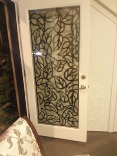 A plasma cut leaf pattern security door guard. Designed and fabricated by www.homegardenart.com