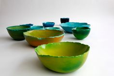 """""""The Balloon Bowls are created by casting strong synthetic plaster into a balloon, after which a second balloon is inserted, and inflated. These two balloons act as flexible moulds, ensuring a unique shape for each and every bowl. Once the plaster is set, the balloons are removed, and a bowl appears."""""""