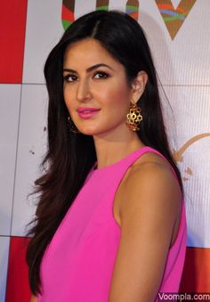 Katrina Kaif looks stunning in a pink sleeveless top by Jill Jill Stuart, earrings by Isharya and pink lips. via Voompla.com