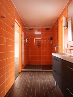 Roca wall tile in Rainbow Azul linesthe bathroomin this renovated master suite in New England. The floor is clad in ceramic plank.