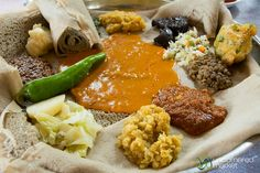 Yetsom Beyaynetu - an Ethiopian dish, is all about eating a variety of different dishes, each of them placed on top of a bed of injera. Eating a Yetsom Beyaynetu is a great way to sample a variety of Ethiopian dishes in a single meal. Normally the mix can include things like shiro wat (chickpea flour curry), misir wat (lentils stew), key wat (beef stew), salata (tomato salad), and any number of other dishes. You can opt for the veg variety too! #snacks #veg #vegetarian #foodie #Ethiopia
