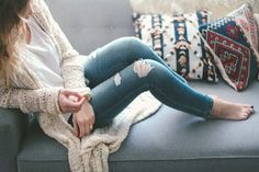 white T, destroyed jeans, cute cardigan