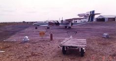 Sierra Leone 1981 - 1985 -Kono, NDMC's Airstrip at Yengema. The Sierra Leone Airways Britten-Norman Trislander [ 9L-LAU], successor to the Islander, used when transferring a shipment of diamonds from the mine to Freetown.