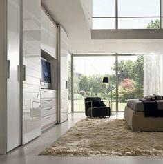 Contemporary wardrobe / glass / sliding door / with TV niche Falegnami