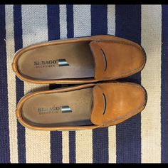 SebagoDockside leather slip ons! These shoes were my Summer go tos! Sebagos are one of my favorite brands for quality. So comfy! Sperry's are great, but seriously! Sebagos are where it's at! Classic look!!! The leather is soft! Price adjusted for wear.  Sebago Shoes Flats & Loafers