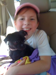 Zoe on the way home with her birthday present:  Diva the Chug.    That's one happy 9 year old !!!!!!!