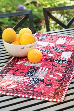 Add some eye-popping color to your décor with this dramatic table runner by Deborah Stanley. These strip-pieced blocks make for streamlined piecing.