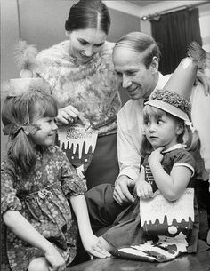 Bobby Charlton, is shown in the picture on the right preparing for Christmas at home with wife Norma and daughters Suzanne and Andrea in 1968.