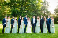 With their April date, Elizabeth and Justin knew they wanted their wedding day to reflect a springtime style. Elizabeth's bridesmaids wore flowing mint green, full-length dresses complemented by Justin's groomsmen, who wore casual navy suits with mint green ties.
