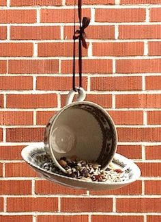 DIY bird feeder made from an old teacup and saucer. For better directions, see: http://birding.about.com/od/Feeders/a/Hanging-Teacup-Bird-Feeder.htm