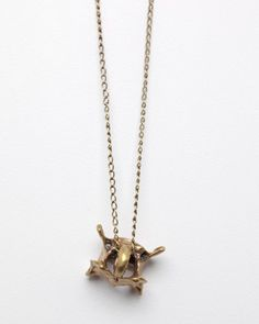 Bones and Feathers Collective V Pendant Necklace (brass plated vertebrae charm)