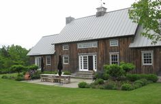 Rural Intelligence Style -they used the board-and-batten siding from an antique Canadian barn to sheathe the exterior.