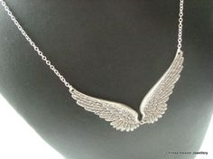Hey, I found this really awesome Etsy listing at https://www.etsy.com/listing/115378572/angel-wing-necklace-antique-silver-angel