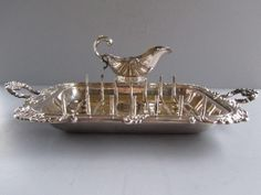 English silver plated asparagus tray, rack and boat produced by the Baker Brothers Company