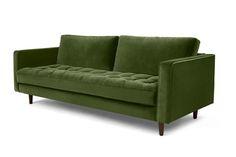 Un canapé 3 places, velours vert impérial. Sa silhouette saisissante parée de boutons est délicatement recouverte de velours somptueux pour un effet couture.