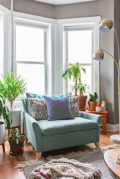 Etsy Trend Expert Decor Tips From Eclectic Brooklyn Home bay window with a cozy, turquoise armchair Bay Window Bedroom, Bay Window Decor, Bay Window Living Room, My Living Room, Home And Living, Living Room Furniture, Living Room Decor, Armchair Living Room, Armchair Table