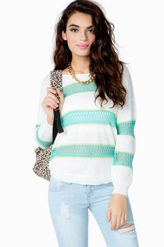 Bring a fun pop of color to your winter look with this cozy knit sweater. Variegated horizontal stripes. Round neck. Long sleeves. Ribbed trimming. Mixed stitch construction. Keep it comfy with skinnies and boots.