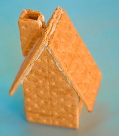 "Make a ""gingerbread"" house in record time.  Very easy option when you don't have time to make the real deal. Hardest part is cutting graham crackers. All it needs now is candy decorations."