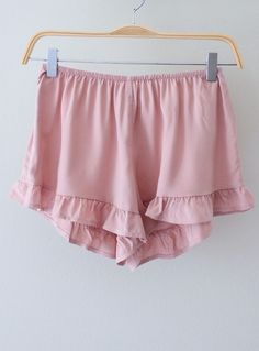 Simple but adorable ruffle shorts to make any summer outfit romantic! Shorts are made of a lightweight, silky material with a ruffled hem. Elastic waistband. Unlined.  Available in BLUSH  BLACK.  Measurements from a Size SMALL (Add half inch for next size up) Waist: 25 inches (elastic) Ris...