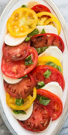 Heirloom Tomato Basil Mozzarella Salad ~ Heirloom tomato, basil, Mozzarella salad made with beautiful, ripe heirloom tomatoes.  Classic Italian Caprese salad recipe. ~ SimplyRecipes.com