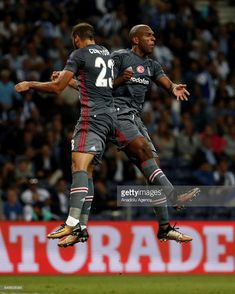 Ryan Babel (R) of Besiktas celebrates with Cenk Tosun (L) after scoring a goal during the UEFA Champions League Group G match between Porto and Besiktas, at Dragon Stadium in Porto, Portugal on September 13, 2017.