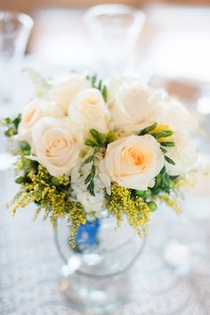 White Rose Centerpiece in Globe Vase   Photo: Alicia Lacey Photography   Flowers: Blue Heron Flowers