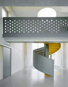 Kindergarten by Ecker Architekten features an austere colour palette and a spiral staircase Colour Architecture, Contemporary Architecture, Architecture Details, Interior Architecture, Interior Stairs, Interior And Exterior, Interior Design, Stair Handrail, Railings