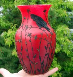 ....Lost Raven Sculpted on Hot Red Recycled Glass Art Vase by Adrianne Kinsella.