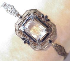 Art Deco Bracelet of Faceted Rock Crystal & Sterling Silver Filigree with Black Enameling.