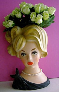 Yes, I would put a ceramic lady head vase in my home.