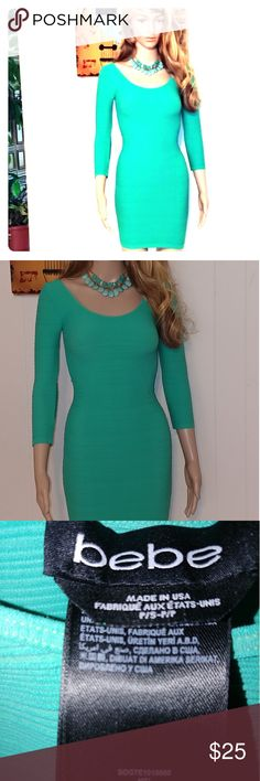 bebe bodycon dress bebe aqua bodycon dress. Sz xs. I love the color and fabric. Its too small on me or I would definitely be wearing it! (That's where my manikin, Felicia goes to work) Lol. Worn once. bebe Dresses Mini
