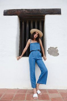 denim jumpsuit, sliders, white mules, sun hat
