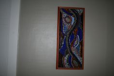 Mosaiced  stone, tile and glass copper and blues mural.