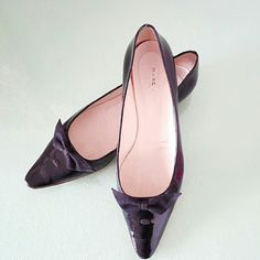 Marc Jacobs  Patent Leather  Flat Shoes Black patent leather flat shoes with bow tie on the front,  been worn and they have some sign of wearing but overall look great. They runs small and perfectly fit size 8 Marc Jacobs Shoes Flats & Loafers