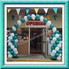 Balloon decor.  White & Teal spiral balloon columns w/string of pearl arch. #Balloonsville
